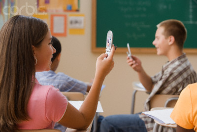 Students using their cell phones in class